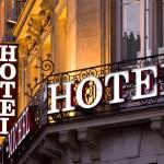Illuminated Parisian hotel sign